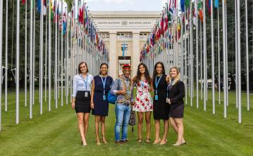 In front of the Palais des Nations with fellow interns and an Indigenous Fellow from Ecuador